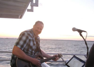 Playing and singing on a booze cruise. My job has it's perks